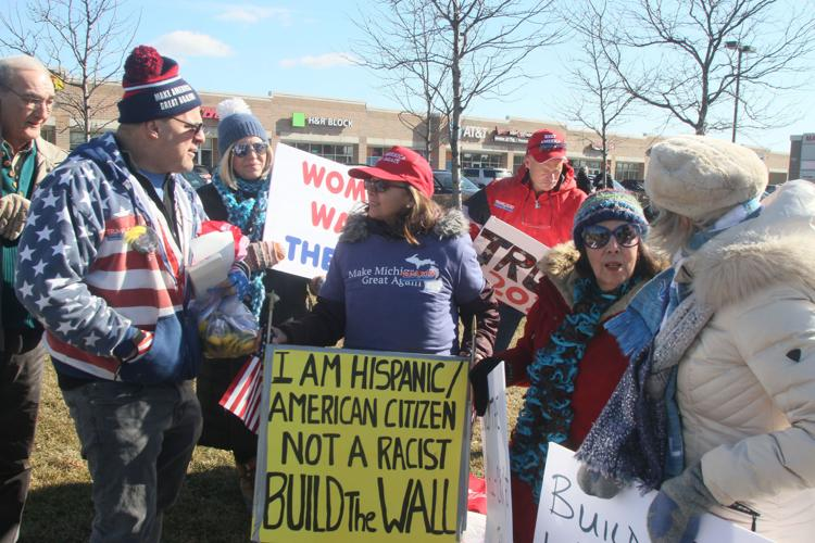 Jazmine Early, center, chats with others during the Saturday, Feb. 9, 2019 rally in Sterling Heights that she helped organize to build public support for construction of a steel wall on the U.S.-Mexico border.  DAVID ANGELL -- FOR THE MACOMB DAILY